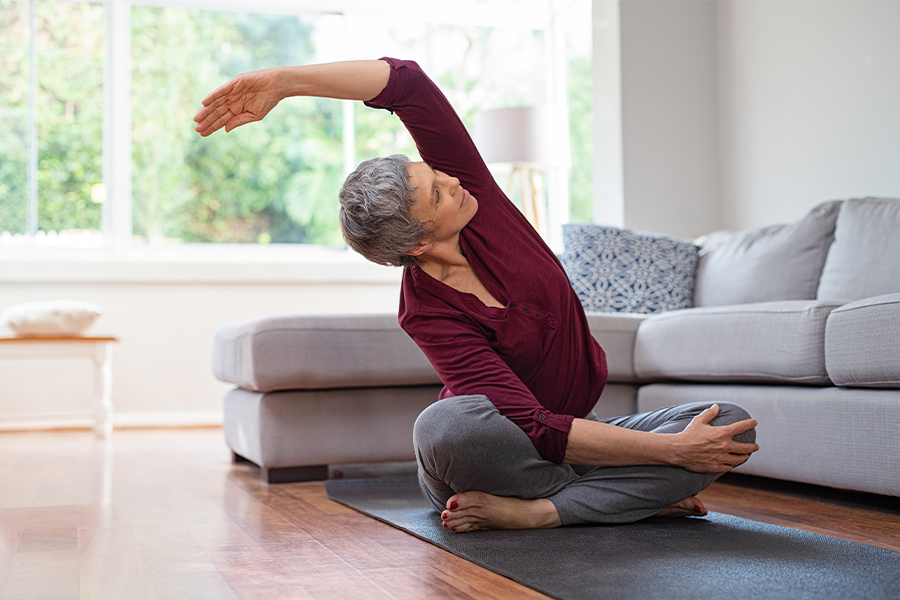 Older woman stretching on the floor